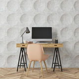 Circle pattern room, computer desk, beige. Empty room interior with gray circle pattern walls and a wooden floor. There is a wooden computer desk and a beige Stock Images
