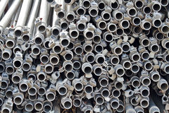 Circle patterns in stacked metal pipes Royalty Free Stock Photo