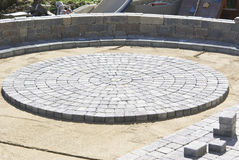 Circle Paver Design. Building progress on Circle Paver Design on the patio sand Royalty Free Stock Photography