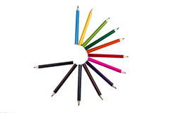 Circle of pencil colors on a white backgroiund. Pencil colors on a white backgroiund royalty free stock photo