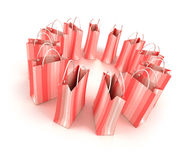 Circle of pink shopping bags Stock Photos