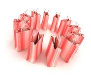 Circle of pink shopping bags Stock Photos