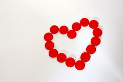 Circle plastic pieces in the heart  shape. Many circle plastic pieces are arrange in the heart shape Stock Photography