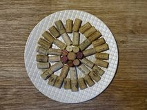 Circle on plate with cork stoppers wooden background royalty free stock photos
