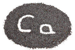 Circle from poppy seeds with letters Stock Images