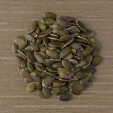 Circle of pumpkin seeds stock image
