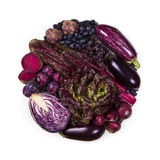 Circle of purple and blue fruits and vegetables Stock Images