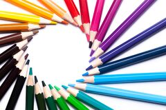 Circle or rainbow swirl of colored pencils on a white background on the left, copy space, mock up, LGBT symbol