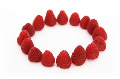 Circle of raspberries 1. Circle made of raspberreis, isolated on white background Stock Photo