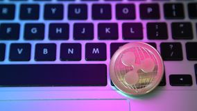 Circle Ripple coin on top of computer keyboard buttons. Digital currency, block chain market, online business