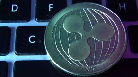 Circle Ripple coin on top of computer keyboard buttons. Digital currency, block chain market, online business.  stock video footage