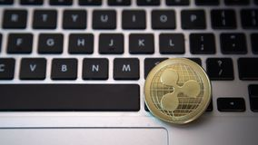 Circle Ripple coin on top of computer keyboard buttons. Digital currency, block chain market, online business.  stock video