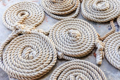 Circle rope prepare for sail ant the port. Circle rope are arranged for sailling at the port near the sea Stock Photo