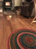 Circle Rug by the fire Stock Photo