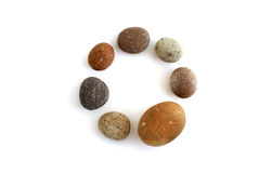 Circle of seven pebbles Stock Image
