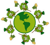 Circle of shamrocks running around a globe Stock Photo