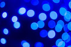 Abstract blue bokeh background. Close up bokeh lights. Circle shape bokeh. Abstract blue bokeh background. Deep blue wallpaper with bokeh effects stock image
