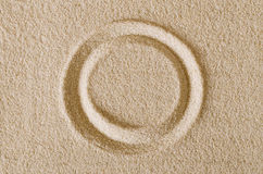 Circle shape imprint in sand surface macro photo Royalty Free Stock Images