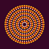 Circle shape made of small candy corns. Halloween holiday trick or treat concept greeting card, poster layout. Royalty Free Stock Photos