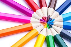 A circle of sharpened colored pencils on a white background. Royalty Free Stock Photo
