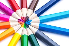 A circle of sharpened colored pencils on a white background. Stock Image