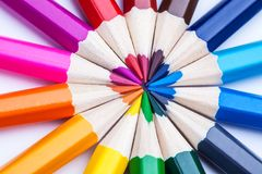 A circle of sharpened colored pencils on a white background. Royalty Free Stock Images