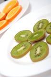 Circle slices of kiwi and orange Stock Images