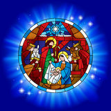 Circle stained glass with the Christmas and Adoration of the Magi Stock Photo