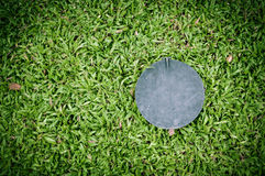 Circle steel plate and Malaysian grass Stock Photo