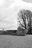 Circle of stones in Avebury. Circle of stones with tree in Avebury with a person standing on top of the hill Royalty Free Stock Photo
