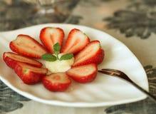 A circle of strawberry salad. Strawberry salad decoration MINT Stock Image