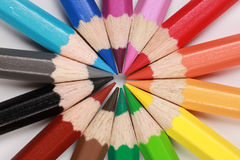 Circle with a target. Colored pencils in a row forming a circle Royalty Free Stock Images