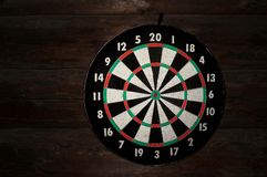 Circle for throwing darts on a wooden wall of logs Royalty Free Stock Photography