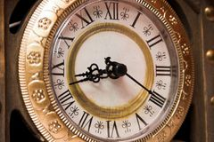 Circle of time. Old wooden clock showing time, close-up Stock Photography