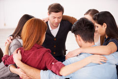 Circle of trust. Group of people sitting in circle and supporting each other Royalty Free Stock Photos