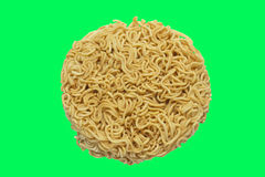 A circle of uncooked Ramen Noodles Isolated on green screen Stock Photo
