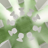 Circle of white chairs in gree. Aerial view of a circle of white chairs on a green floor