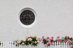 Circle Window. White wall with a circle window Royalty Free Stock Photo