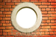 Circle window on brick wall Royalty Free Stock Image