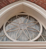 Circle window in historic church. This historic church features a beautiful circle window with a flower design. Inspirational and calming Stock Images