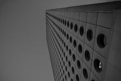 Circle Windows on a futuristic building. In a city in Asia Royalty Free Stock Images