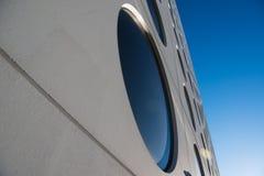 Circle windows. Modern futuristic facade with circle window stock image