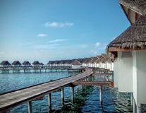 Circle wooden bridge to dot hut in maldives island Stock Photography