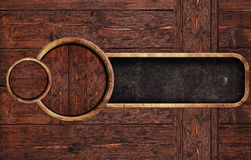 Circle wooden sign on wooden backround Stock Photos