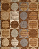 Circles. Gray and brown circles and squares on fabric Royalty Free Stock Photos