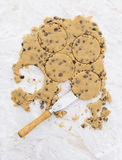 Circles in chocolate chip cookie dough with palette knife Stock Photos
