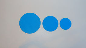 Circles of different sizes. Blue circles of different sizes including large, medium, and small. Abstract concept of different sizes of the same shape royalty free stock photo