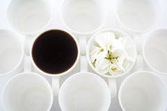 Circles. Empty Coffee cups with flower two filled in the middle Stock Photography