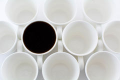 Circles. Empty Coffee cups  with one filled cup Stock Photos