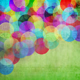 Circles on green grunge background Stock Photography